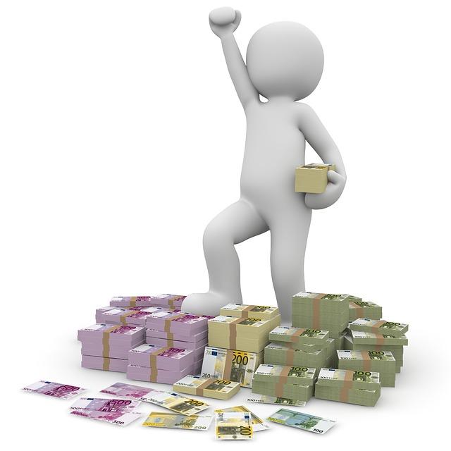 vítězství – panáček na hromadě bankovek